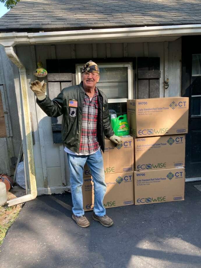 Bruce Falls, commander of American Legion Post 38 in Torrington and a Vietnam veteran, delivers a donation of toilet paper from Home Depot to the Veterans Service Office. Photo: Dawn McGowan / Contributed Photo