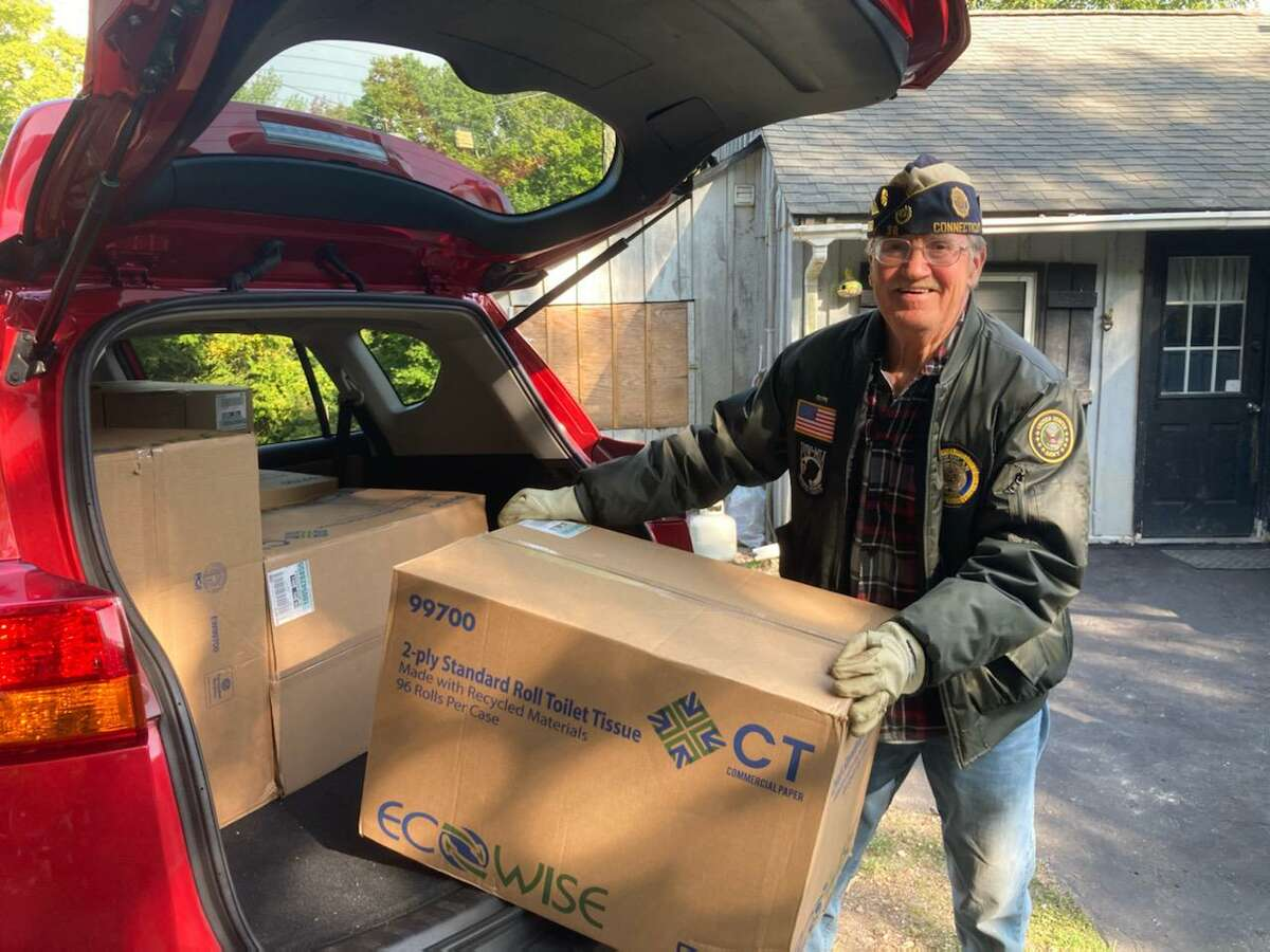 Bruce Falls, commander of American Legion Post 38 in Torrington and a Vietnam veteran, delivers a donation of toilet paper from Home Depot to the Veterans Service Office.