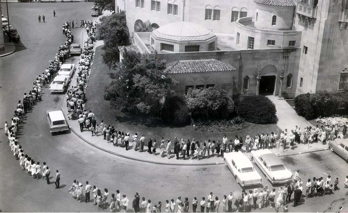 In an Express-News file photo. In response to a mini-epidemic of polio, crowds line up outside the Municipal Auditorium for vaccinations in 1962. undated photo.