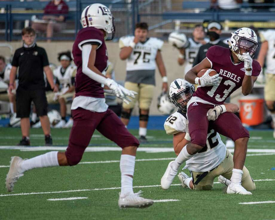 Lee's Shemar Davis (13) is tackled by Amarillo's Cooper Ivey (32) as Lee's Michael Valles watches Friday, Sept. 25, 2020 at Grande Communications Stadium. Jacy Lewis/Reporter-Telegram Photo: Jacy Lewis/Reporter-Telegram / MRT
