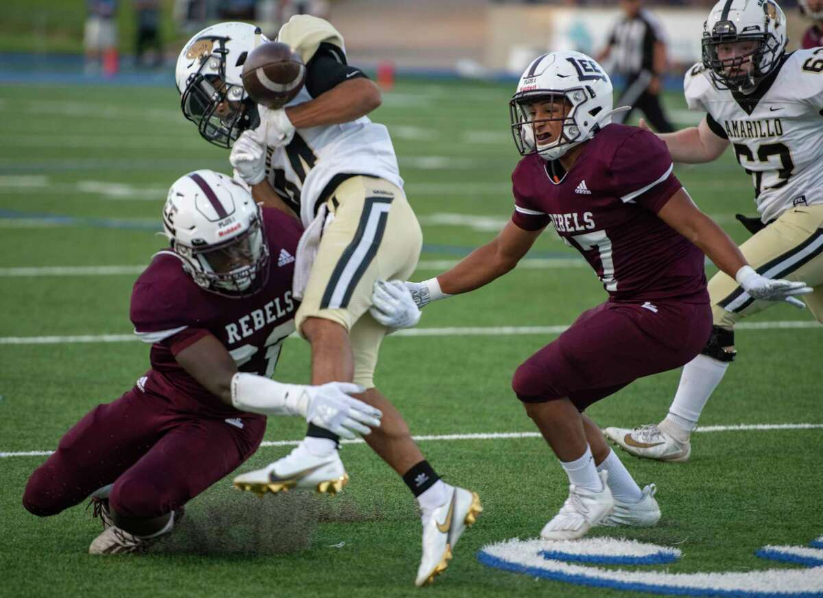 Lee's Canyon Moses dislodges the ball from Amarillo's Taevon Hood as Lee's Jacob Maltos assists Friday, Sept. 25, 2020 at Grande Communications Stadium. Jacy Lewis/Reporter-Telegram