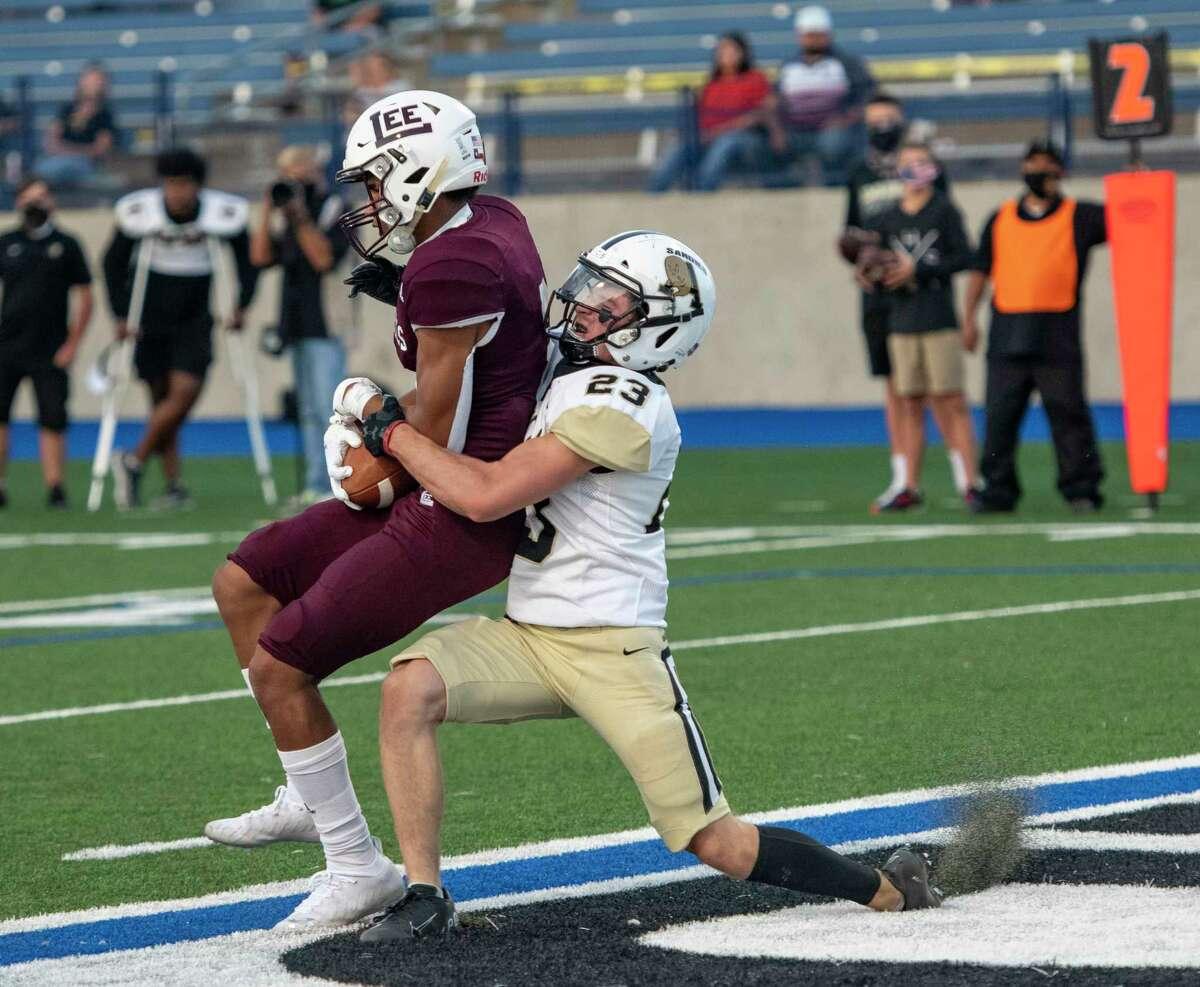 Lee's Christian Romero scores a touchdown as Amarillo's Trey Thomas tackles Romero Friday, Sept. 25, 2020 at Grande Communications Stadium. Jacy Lewis/Reporter-Telegram