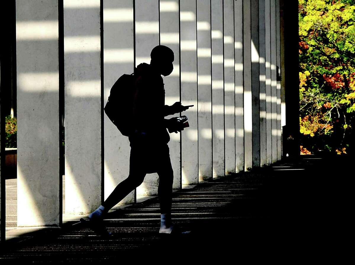 A student wearing a mask is seen walking near the campus center of University at Albany on Friday, Sept. 25, 2020 in Albany, N.Y. (Lori Van Buren/Times Union)