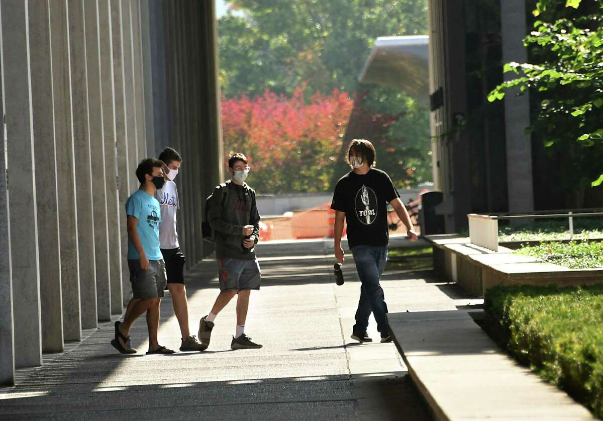 Students wearing masks are seen walking near the campus center of University at Albany on Friday, Sept. 25, 2020 in Albany, N.Y. (Lori Van Buren/Times Union)