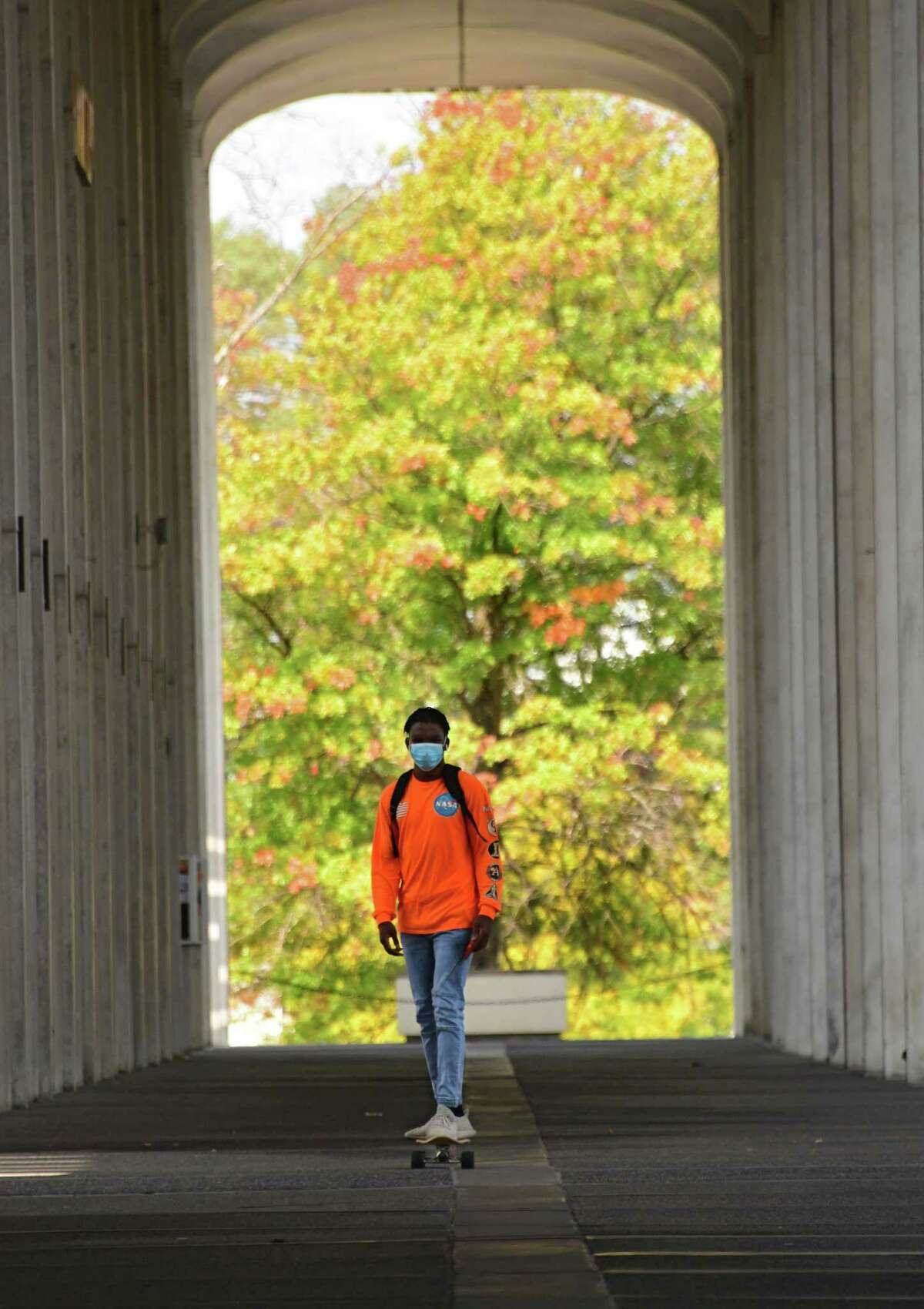 A student waering a mask is seen skateboarding near the campus center of University at Albany on Friday, Sept. 25, 2020 in Albany, N.Y. (Lori Van Buren/Times Union)