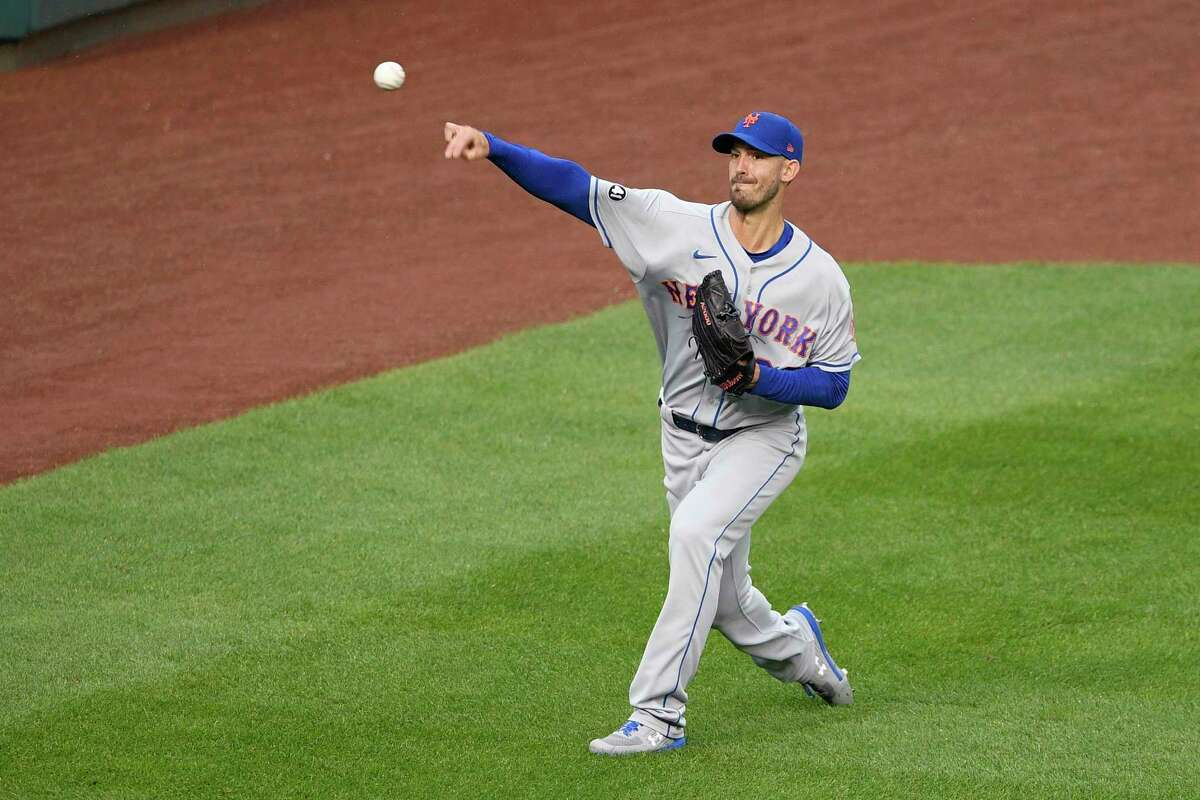 New York Mets starting pitcher Rick Porcello tosses the ball before a baseball game against the Washington Nationals, Friday, Sept. 25, 2020, in Washington. The game was postponed due to inclement weather. (AP Photo/Nick Wass)