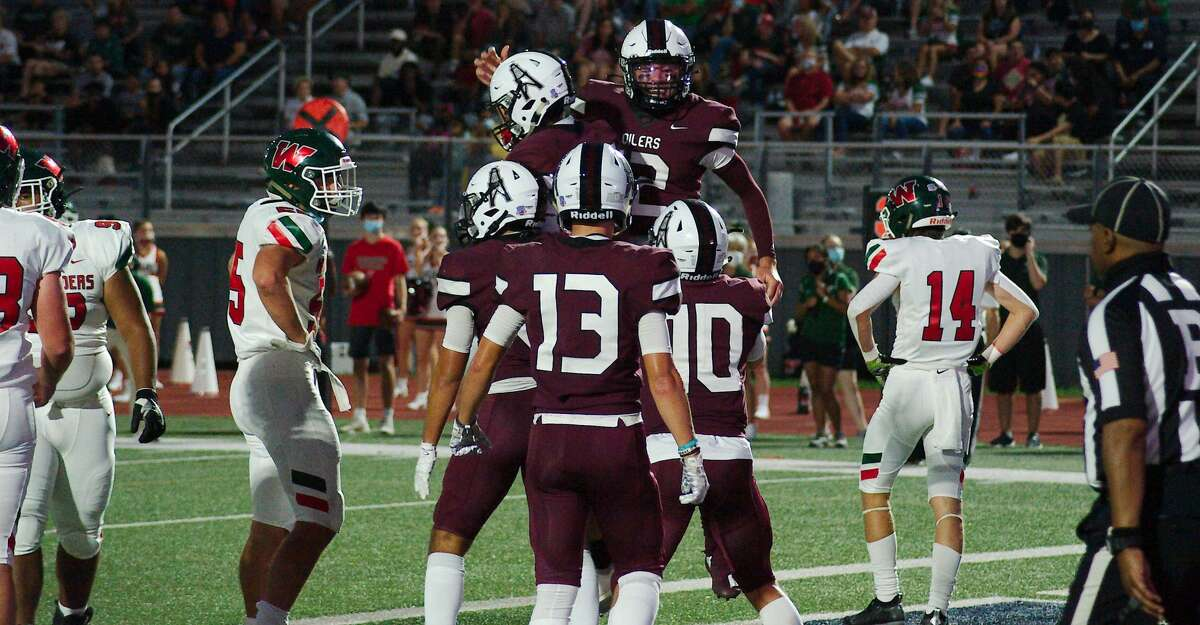 Pearland's William Foster (15) and Pearland's Jake Sock (12) celebrate a touchdown against The Woodlands Friday at The Rig.