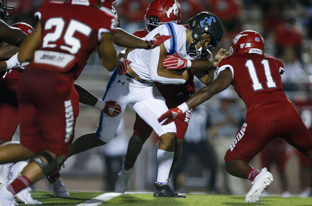 Shadow Creek quarterback Kyron Drones (1) runs the ball against North Shore during the first half of the game at Galena Park ISD Stadium on Friday, Sept. 25, 2020, in Houston.