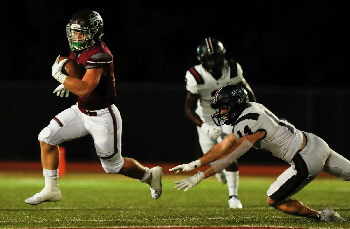 Magnolia running back Mitch Hall (5) picks up a first down during the second quarter of a non-district high school football game at Bulldog Stadium, Friday, Sept. 25, 2020, in Magnolia.