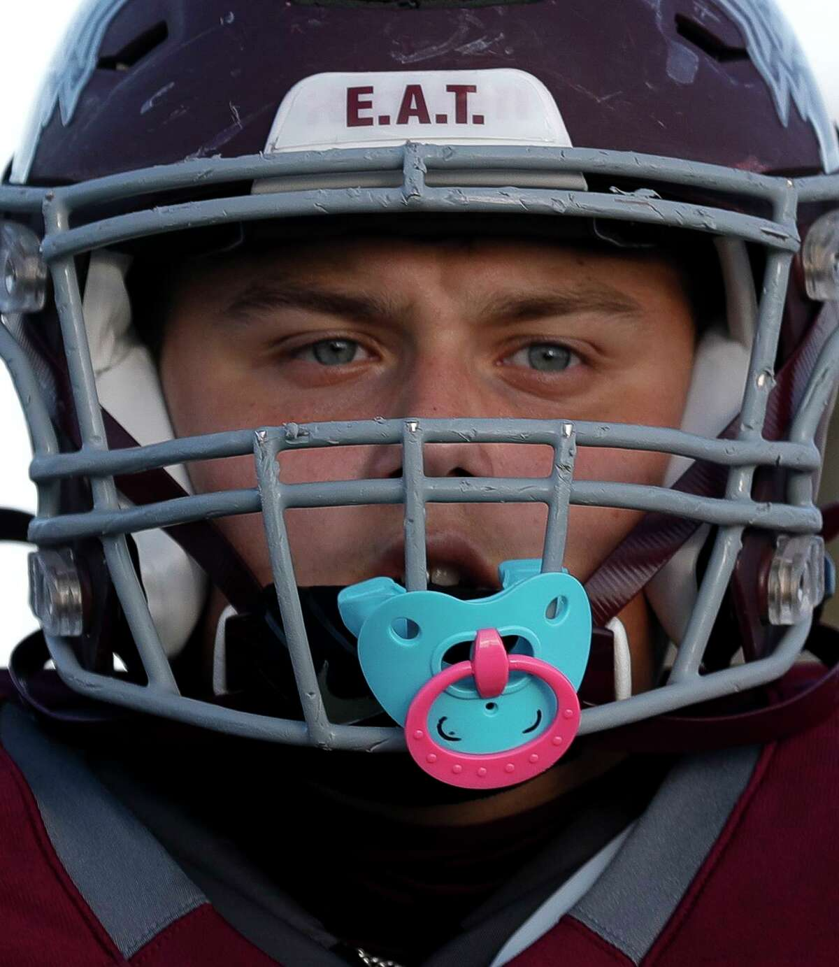 Magnolia offensive linemen Carson Mitchell's mouthpiece resembles a child's pacifier as he warms up before a non-district high school football game at Bulldog Stadium, Friday, Sept. 25, 2020, in Magnolia.
