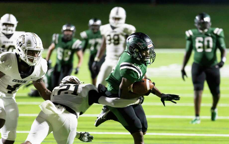 Mayde Creek wide receiver Leroy Turner (8) runs the ball passed Conroe defensive back Jaden Williams (21) for a touchdown during the second quarter of a non-district football game at Rhodes Stadium in Katy, Friday, Sept. 25, 2020. Photo: Gustavo Huerta, Houston Chronicle / Staff Photographer / 2020 © Houston Chronicle