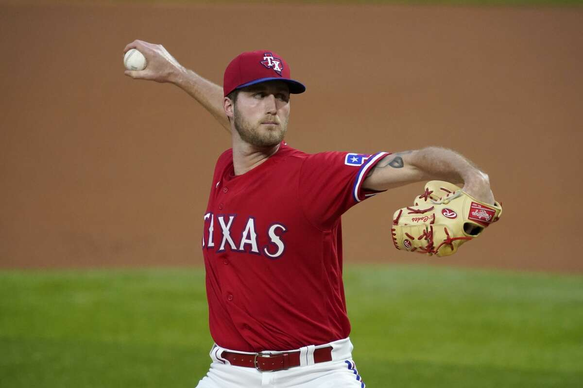 Texas Rangers starting pitcher Kyle Cody throws to the Houston Astros in the first inning of a baseball game in Arlington, Texas, Friday, Sept. 25, 2020. (AP Photo/Tony Gutierrez)