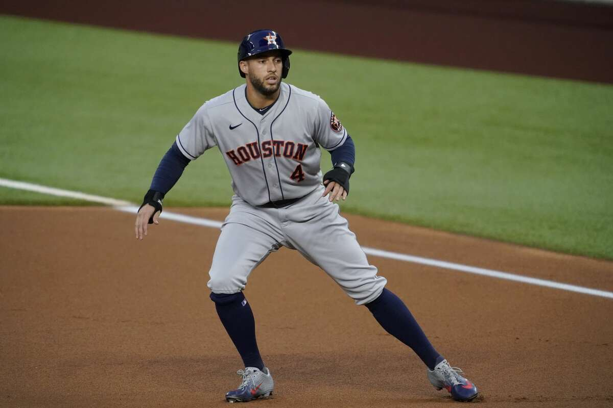 Houston Astros' George Springer takes a lead off of first in the first inning of a baseball game against the Texas Rangers in Arlington, Texas, Friday, Sept. 25, 2020. (AP Photo/Tony Gutierrez)