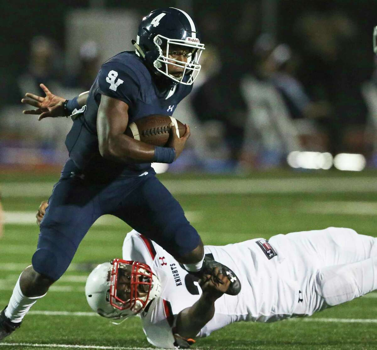 Smithson Valley's Jalen Nutt eludes a tackler en route to 78 rushing yards and a TD. He also passed for 125 yards and a TD.
