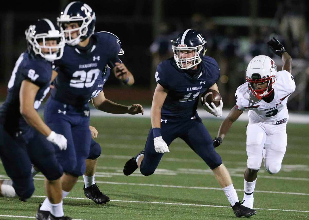 Ranger defender Blake Bowman picks up blockers after making an interception to end the first half as Smithson Valley hosts Harker Heights in high school football at Smithson Valley on Sept. 25, 2020.