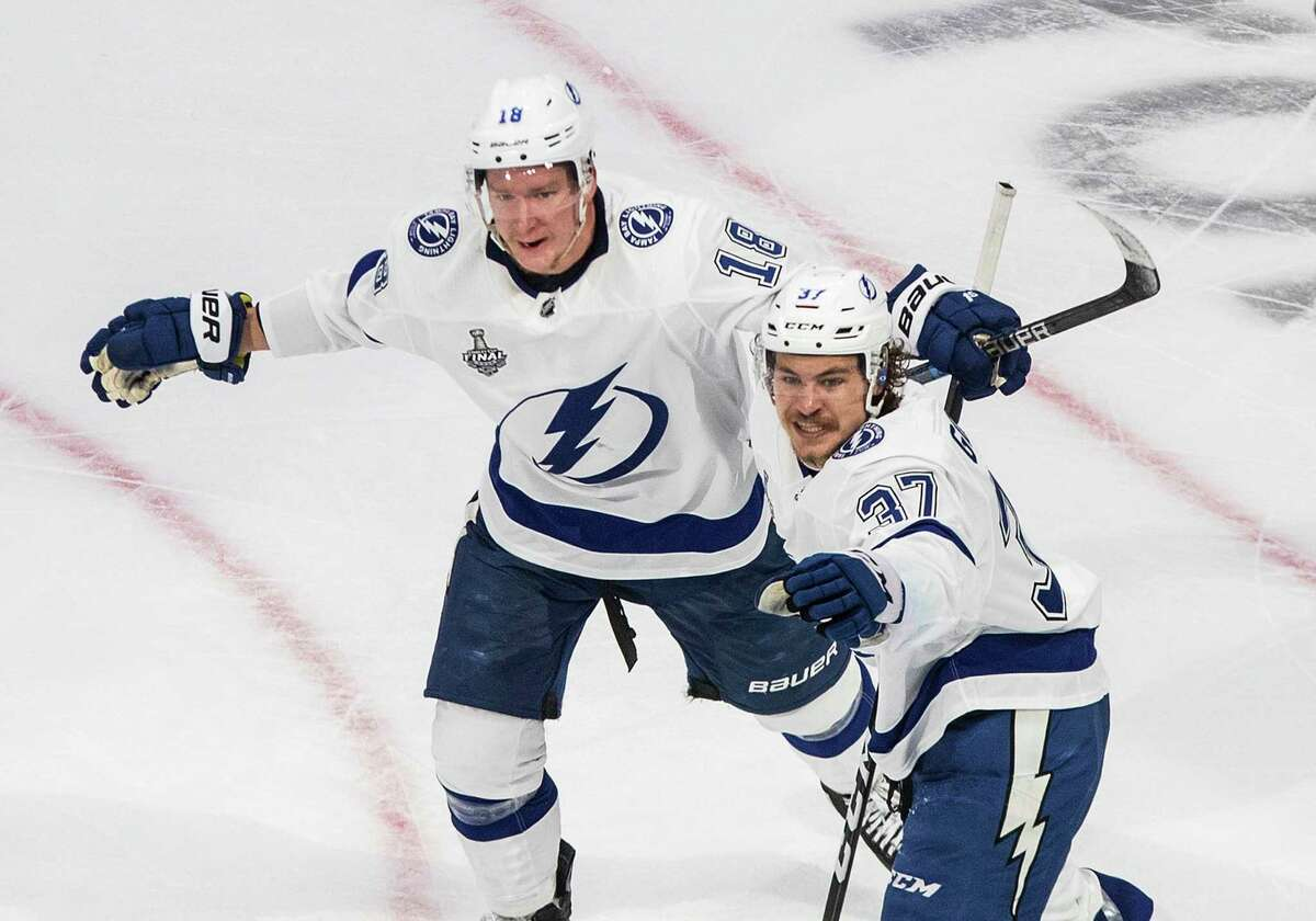 Tampa Bay Lightning left wing Yanni Gourde (37) celebrates his goal against the Dallas Stars with Ondrej Palat (18) during the second period of Game 4 of the NHL hockey Stanley Cup Final, Friday, Sept. 25, 2020, in Edmonton, Alberta. (Jason Franson/The Canadian Press via AP)