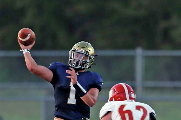 Holy Cross QB Jordan Battles looks to pass against Austin Hyde-Park in the first half. Austin Hyde-Park v Holy Cross at Wheatley Heights Sports Complex on Friday, September 25, 2020. Halftime score Holy Cross 21 Austin Hyde-Park 14.