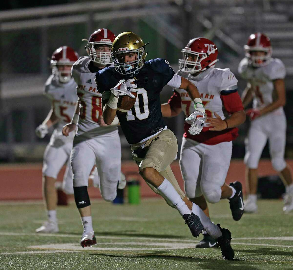 Holy Cross Marcos Jimenez-Cedillo rubles for a touchdown in third quarter. Austin Hyde-Park v Holy Cross at Wheatley Heights Sports Complex on Friday, September 25, 2020. Holy Cross led in fourth quarter 49-26.