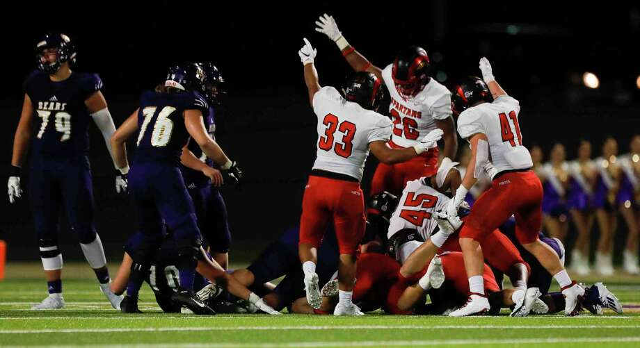 Porter players react after defensive linemen Jose Lopez recovered a fumble by Montgomery quarterback Brock Bolfing during the first quarter of a non-district high school football game at Bulldog Stadium, Friday, Sept. 25, 2020, in Magnolia. Photo: Jason Fochtman, Houston Chronicle / Staff Photographer / 2020 © Houston Chronicle