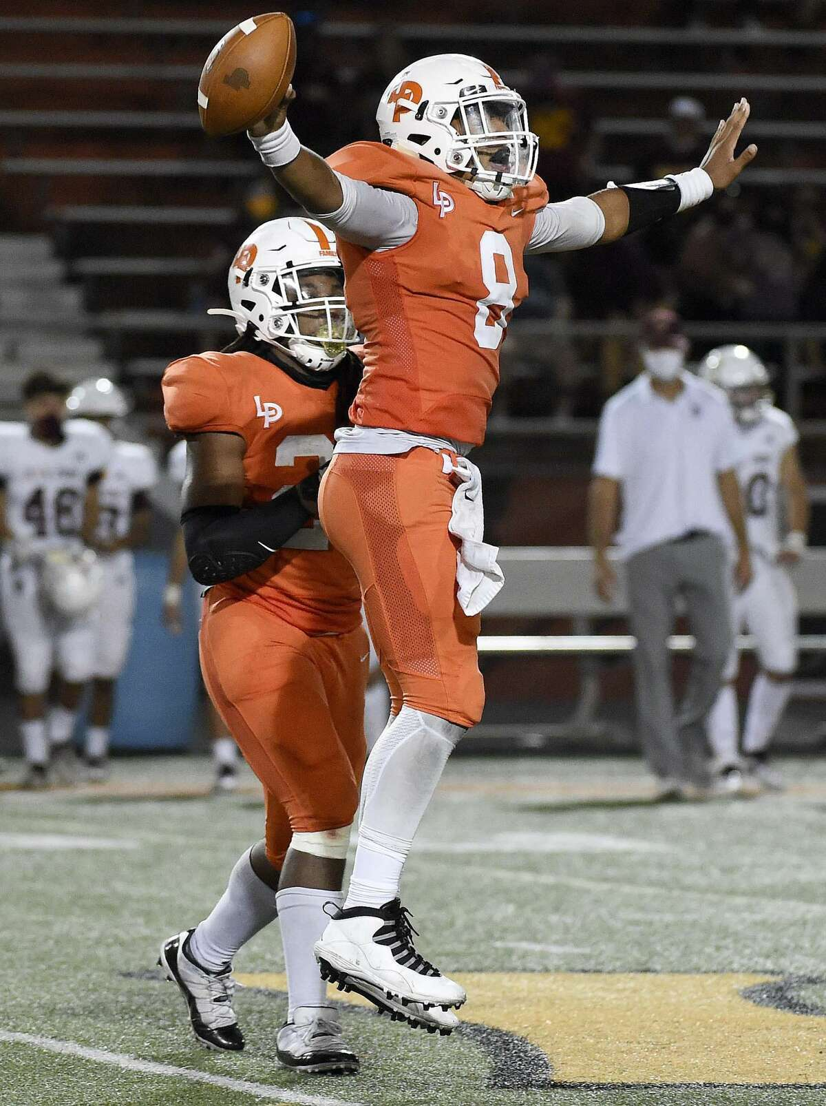La Porte quarterback Cooper Upshaw, right, celebrates the team's win with Eric Bright after a high school football game against Deer Park, Friday, Sept. 25, 2020, in La Porte.