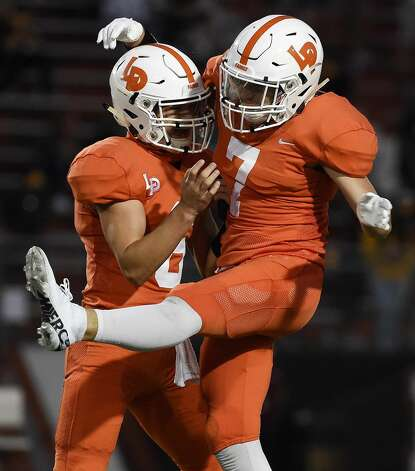 La Porte kicker Levi Hillborn, right, celebrates his 45-yard field goal with Tristen Spears during the first half of a high school football game against Deer Park, Friday, Sept. 25, 2020, in La Porte. Photo: Eric Christian Smith/Contributor