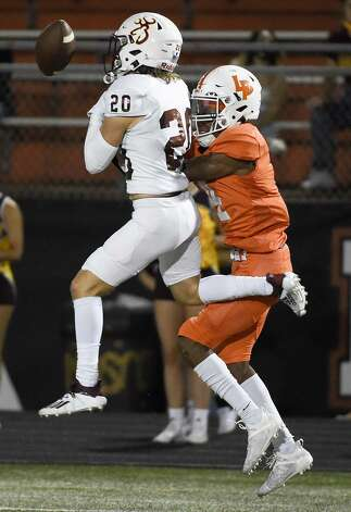 Deer Park defensive back Dylan Jones (20) breaks up a pass intended for La Porte wide receiver Travis Greenawalt during the first half of a high school football game, Friday, Sept. 25, 2020, in La Porte. Photo: Eric Christian Smith/Contributor
