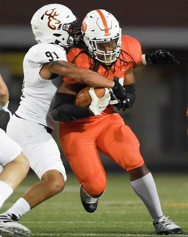 La Porte running back Eric Bright, right, is tackled by Deer Park linebacker Cookie Garcia during the first half of a high school football game, Friday, Sept. 25, 2020, in La Porte. Photo: Eric Christian Smith/Contributor
