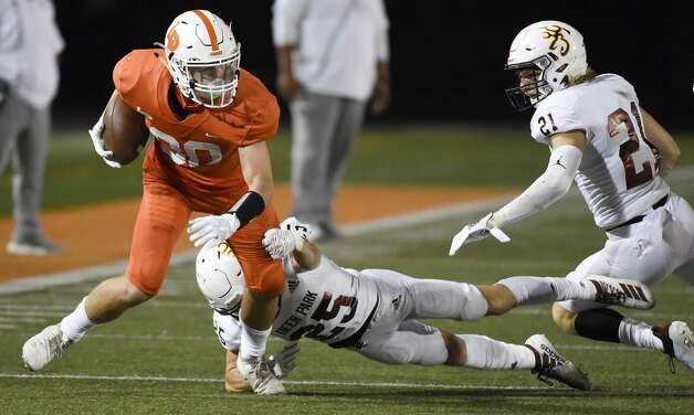 La Porte wide receiver Austin Escobar, left, breaks the tackle of Deer Park defensive back Jake Schaper (25) during the second half of a high school football game, Friday, Sept. 25, 2020, in La Porte. Photo: Eric Christian Smith/Contributor