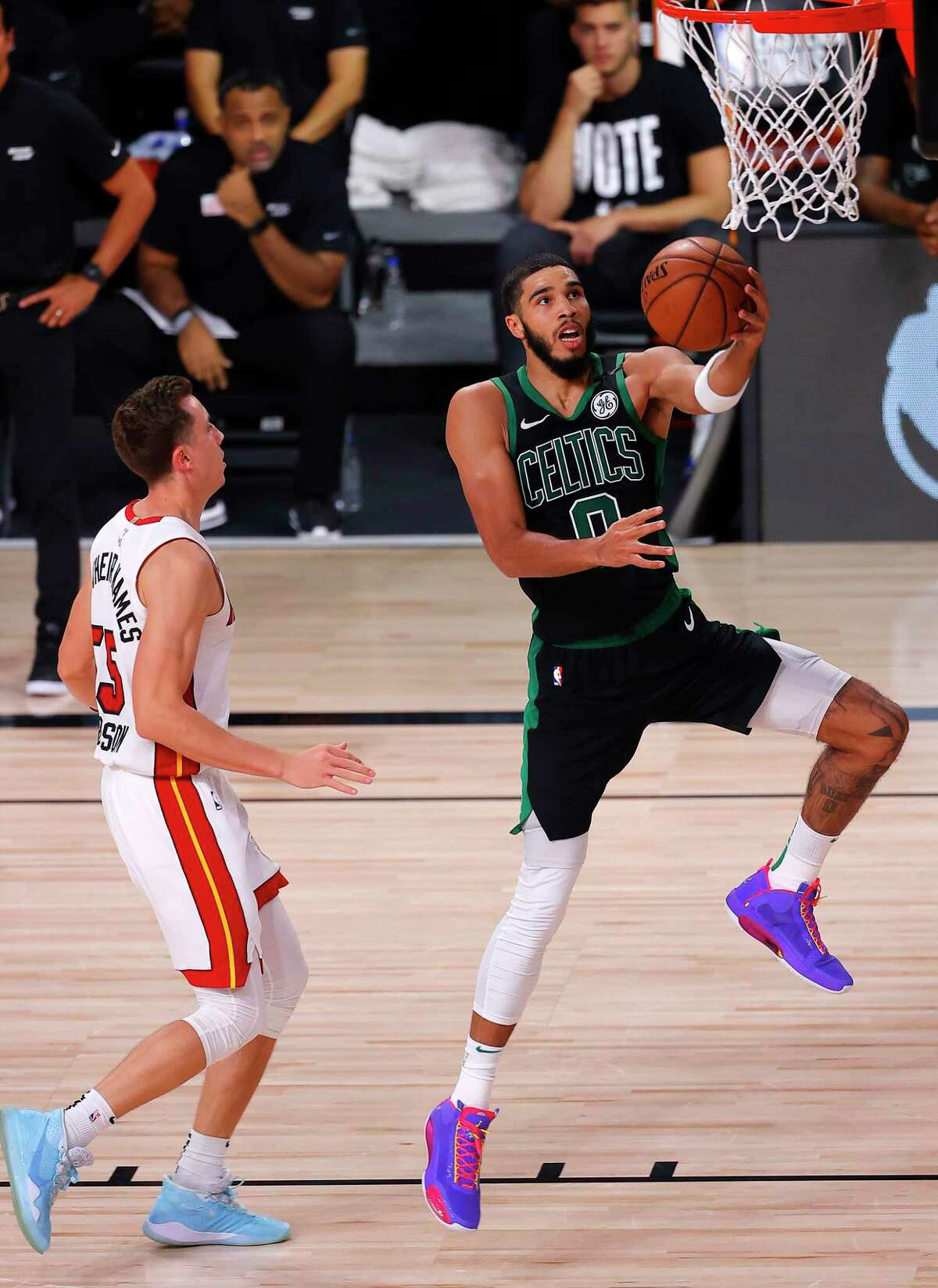 LAKE BUENA VISTA, FLORIDA - SEPTEMBER 25: Jayson Tatum #0 of the Boston Celtics goes for a lay-up against Duncan Robinson #55 of the Miami Heat during the fourth quarter in Game Five of the Eastern Conference Finals during the 2020 NBA Playoffs at AdventHealth Arena at the ESPN Wide World Of Sports Complex on September 25, 2020 in Lake Buena Vista, Florida. NOTE TO USER: User expressly acknowledges and agrees that, by downloading and or using this photograph, User is consenting to the terms and conditions of the Getty Images License Agreement. (Photo by Mike Ehrmann/Getty Images)