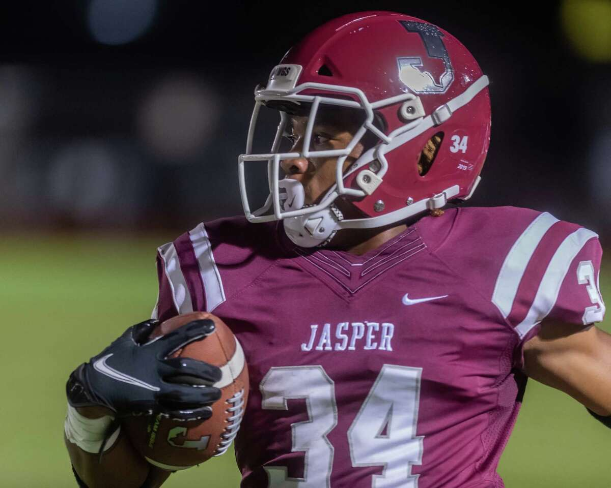 Carl Limbrick (34) carries the ball. The Jasper Bulldogs opened their football season with the opener against the Silsbee Tigers in Jasper on Friday night. Photo made on September 4, 2020. Fran Ruchalski/The Enterprise