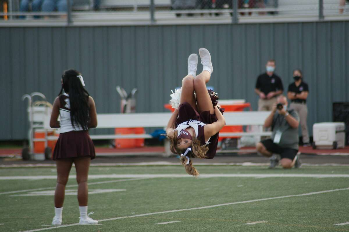 The Pearland cheerleaders are introduced before the game against The Woodlands Friday at The Rig.