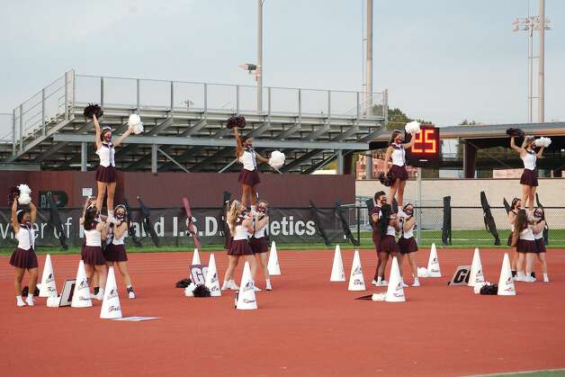 The Pearland cheerleaders perform before the game against The Woodlands Friday at The Rig. Photo: Kirk Sides/Staff Photographer / © 2020 Houston Chronicle/Kirk Sides