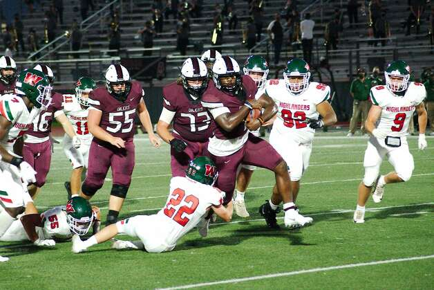 Pearland's Darius Hale (4) fights for yardage past The Woodlands Hayden Bonds (22) Friday at The Rig. Photo: Kirk Sides/Staff Photographer / © 2020 Houston Chronicle/Kirk Sides