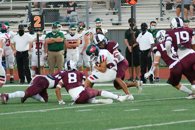 The Woodlland's Ben Ferguson (6) is it by Pearland's Dylan Dixson (7) Friday at The Rig. Photo: Kirk Sides/Staff Photographer / © 2020 Houston Chronicle/Kirk Sides