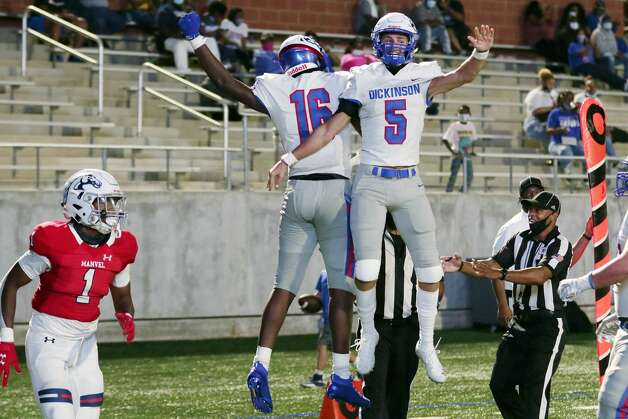 Dickinson's Donovan Green (16) and Jquan Hennigan (5) celebrate Green touchdown pass reception by Manvel's Collin Wright (1) during the first half of their scrimmage at Freedom Field Sept. 25, 2020 in Arcola, TX. Photo: Michael Wyke/Contributor / © 2020 Houston Chronicle