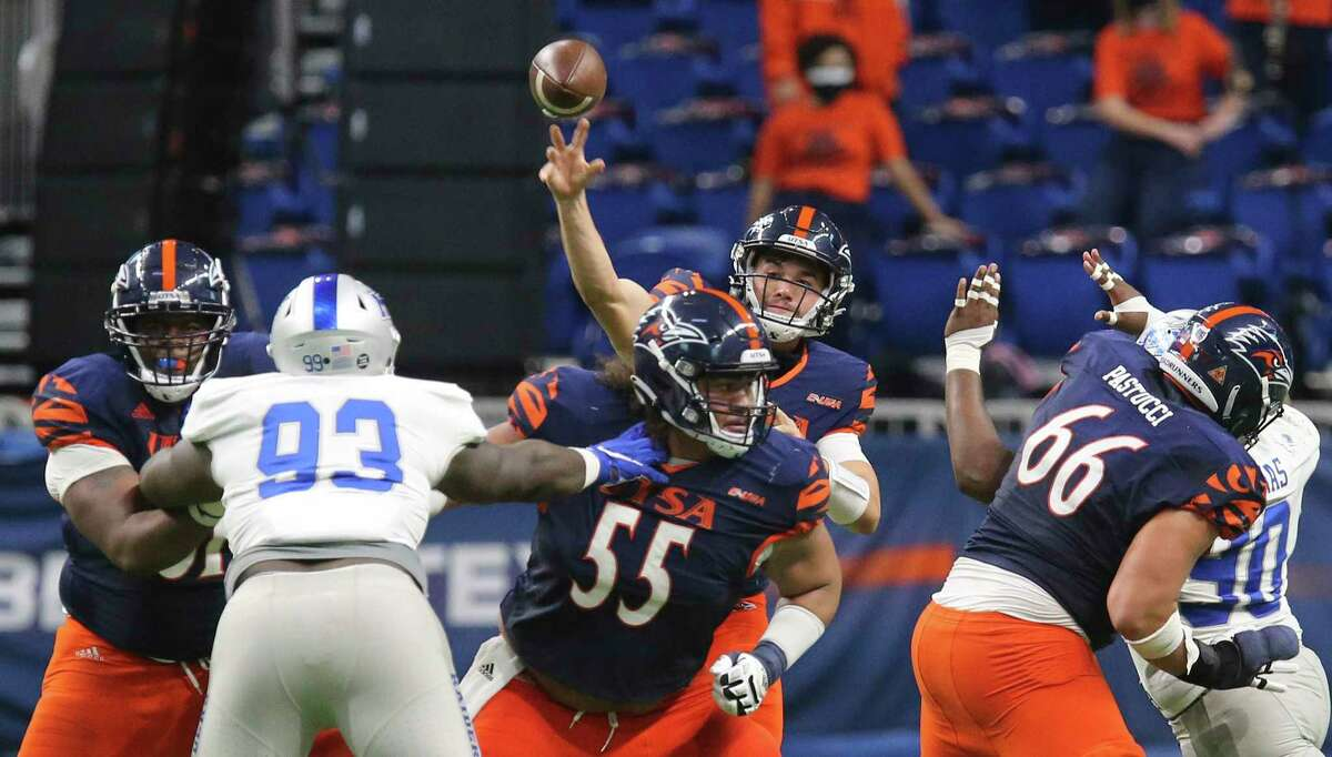 UTSA quarterback Josh Adkins (center) throws over his linemen against Middle Tennessee during their game at the Alamodome on Friday, Sept. 25, 2020. UTSA wins, 37-35, over Middle Tennessee.