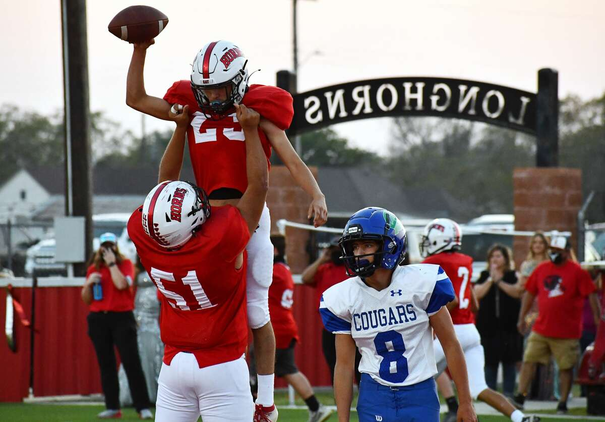 Lockney's Anson Rendon is lifted into the air by teammate Cristian Gonzales (51) after scoring a touchdown against Compass Academy during their 67-0 non-district high school football game on Friday, Sept. 25, 2020 at Lockney.