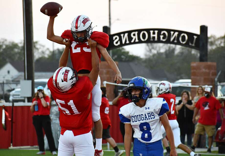 Lockney's Anson Rendon is lifted into the air by teammate Cristian Gonzales (51) after scoring a touchdown against Compass Academy during their 67-0 non-district high school football game on Friday, Sept. 25, 2020 at Lockney. Photo: Nathan Giese/Planview Herald