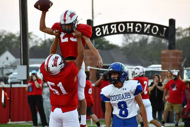 Lockney's Anson Rendon is lifted into the air by teammate Cristian Gonzalez (51) after scoring a touchdown against Compass Academy during their 67-0 non-district high school football game on Friday, Sept. 25, 2020 at Lockney.