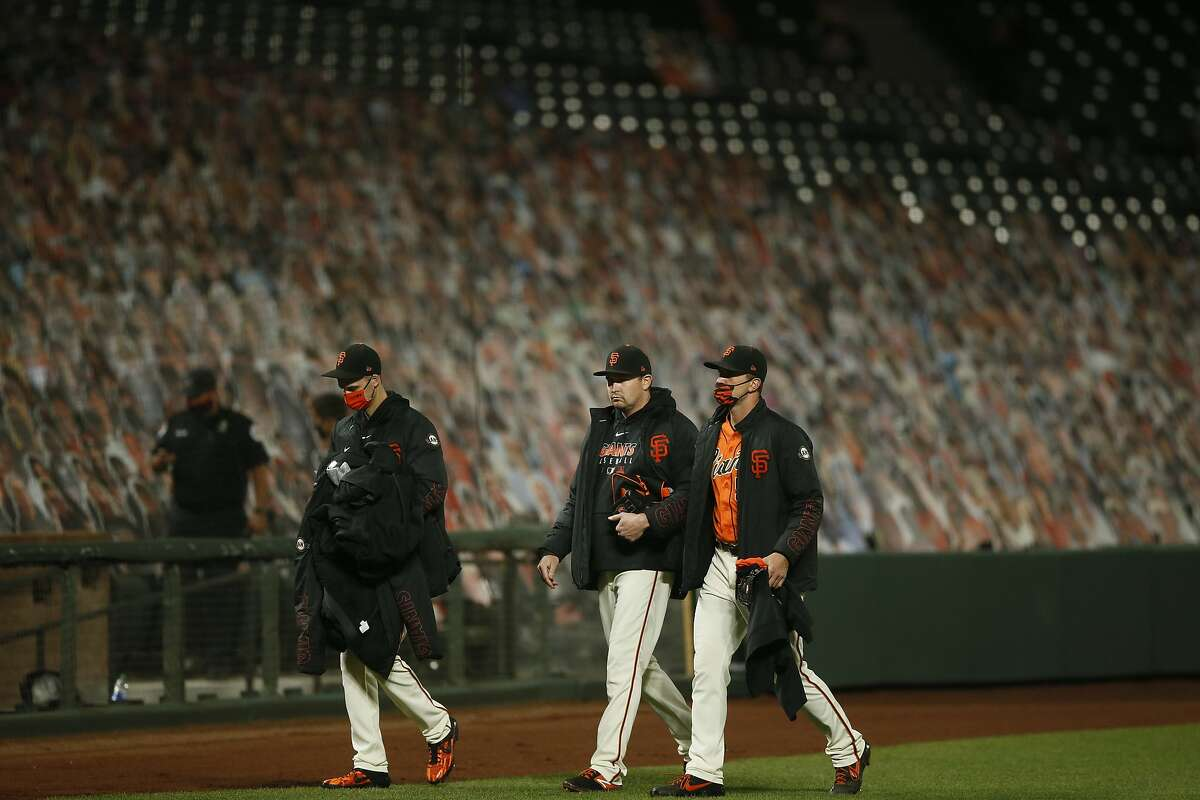 Top: The Giants' bullpen leaves Oracle Field after coughing up a late lead to the Padres in Game 2.