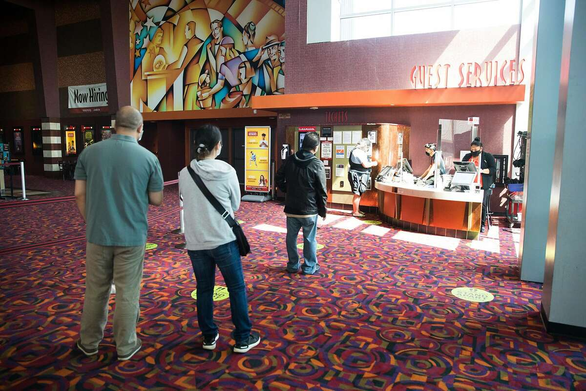Customers line up to purchase movie tickets. For the first time since March, the Century at Tanforan movie theater opened to the public for screenings on Sept. 25, 2020. Movie theaters in San Mateo County are now allowed to have patrons watch movie screenings, but capacity is capped at 25% due to COVID-19 restrictions.
