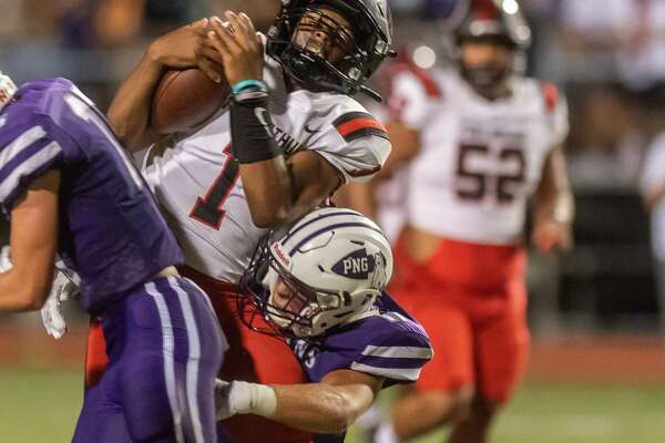 Titans quarterback Jah'mar Sanders (1) is wrapped up on a quarterback keeper in the first quarter. Port Neches-Groves hosted Port Arthur Memorial in the 5A season opener for both programs. Photo made on September 25, 2020. Fran Ruchalski/The Enterprise