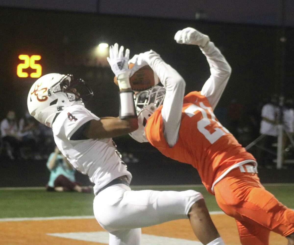 Deer Park receiver Terrance Smith and a La Porte defender get tangled up as each vie for this pass attempt near the end zone during first-half action Friday night. The ball fell incomplete.