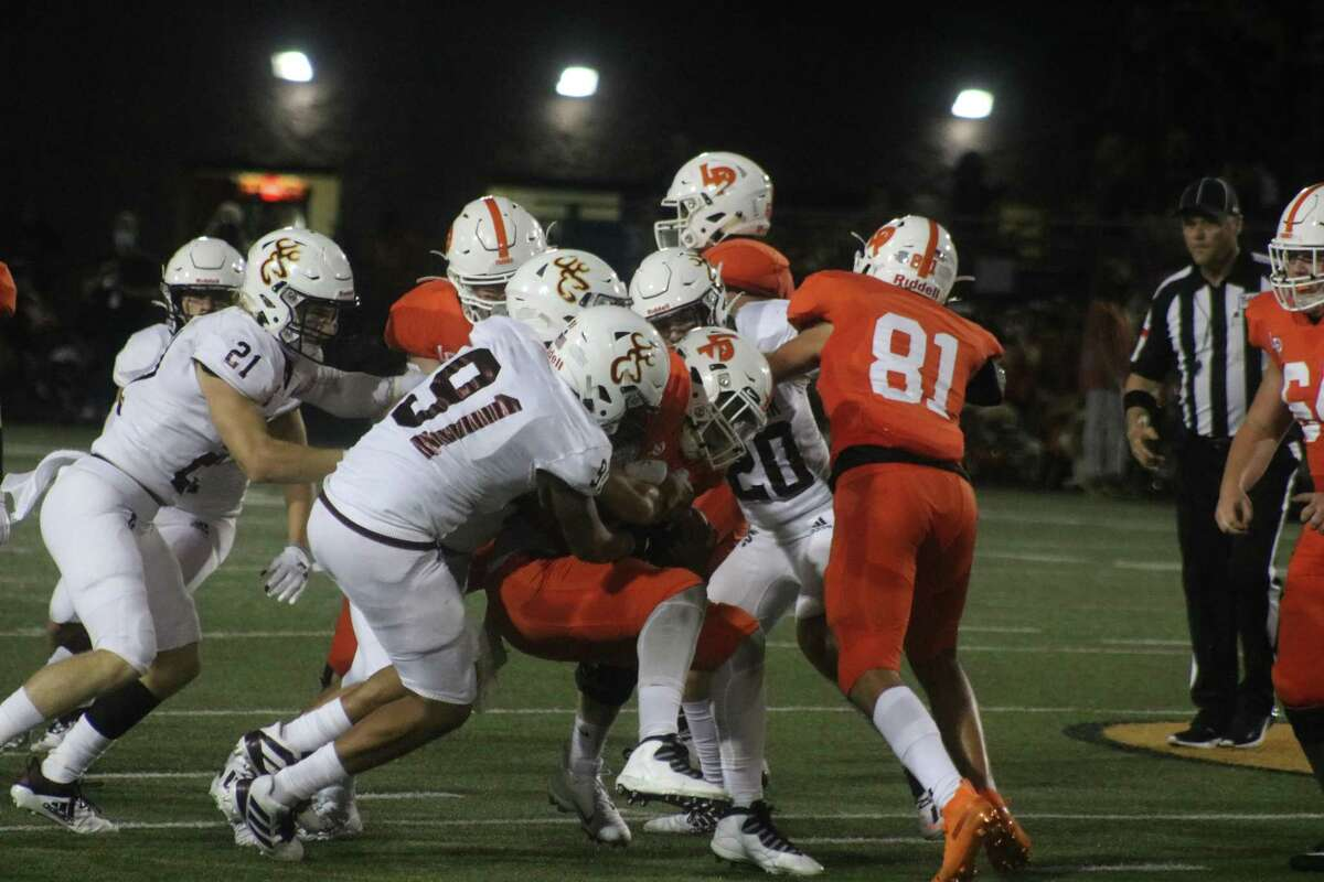 The Deer defense stops a Bulldog near the line of scrimmage. The defense kept the Deer within striking distance, but the offense never found the end zone.