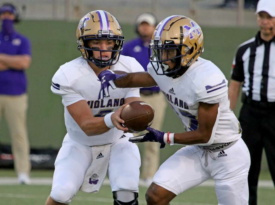 Midland High's Landry Walls hands the ball to Daniel Garcia against Rider Friday, Sept. 25, 2020, at Memorial Stadium in Wichita Falls. Photo: Lauren Roberts/Times Record News