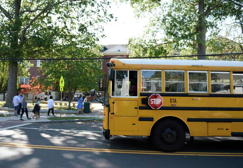 A school bus picks up students during dismissal at Old Greenwich School in Old Greenwich, Conn. Wednesday, Sept. 23, 2020. Photo: File / Tyler Sizemore / Hearst Connecticut Media / Greenwich Time