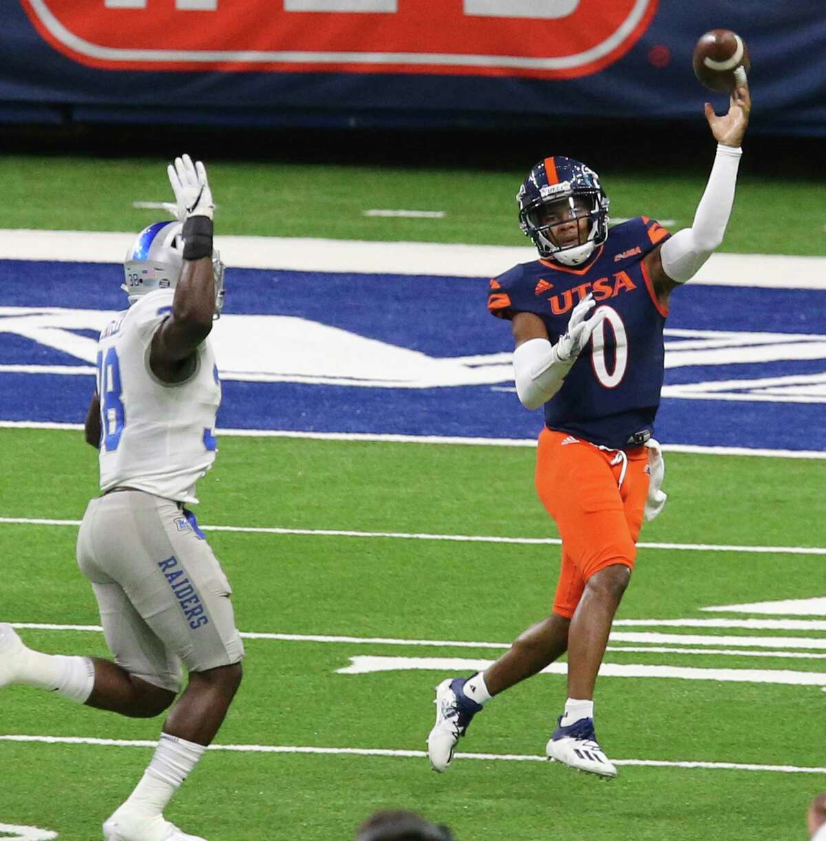 UTSA quarterback Frank Harris (0) makes a pass attempt against Middle Tennessee's Johnathan Butler (38) during their game at the Alamodome on Friday, Sept. 25, 2020.