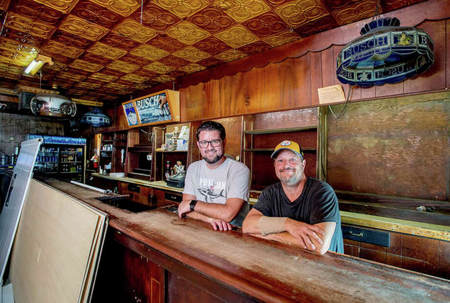 Mark Donahue (left) and Bob Bullock are in the process of renovating the popular bar Mike's Tavern in West Peoria. The former garage and barbershop was converted to a bar in 1938 and has attained a near-legendary status over the years. Photo: Matt Dayhoff   Journal Star (AP)