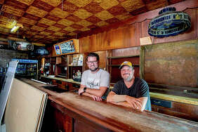 Mark Donahue (left) and Bob Bullock are in the process of renovating the popular bar Mike's Tavern in West Peoria. The former garage and barbershop was converted to a bar in 1938 and has attained a near-legendary status over the years.