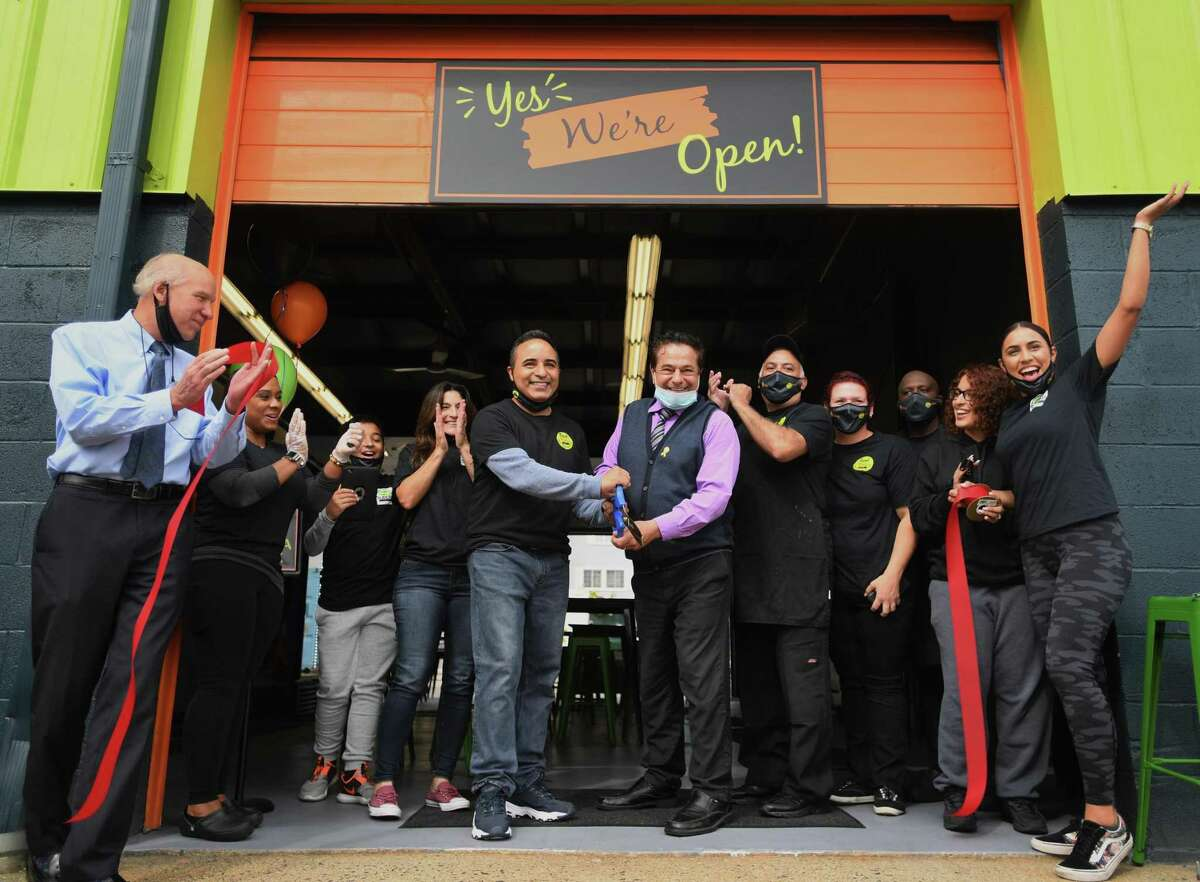 Food Trucks & Co. Owner Ernie Nieves and Ansonia Mayor David Cassetti cut the ribbon on the new business on Howard Avenue in Ansonia, Conn. on Thursday, September 24, 2020.